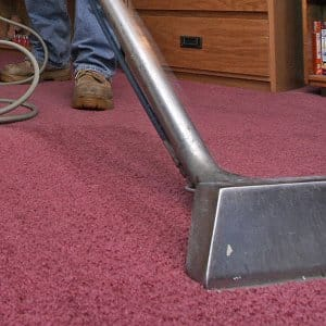 Machine cleaning carpet.