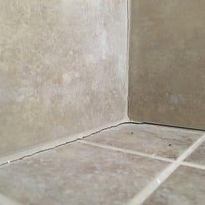 cracks in shower tile grout corners