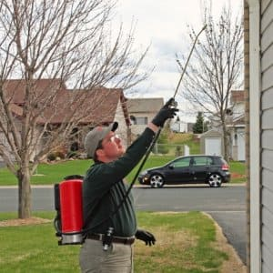 Larry Rufledt Jr. of Westside Pest Solutions in Hanover, Minnesota, sprays a home for a pest control problem. (Photo by John Molene)