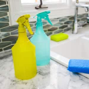 spray bottles and sponges for cleaning