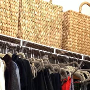 organized closet with baskets and slim hangers
