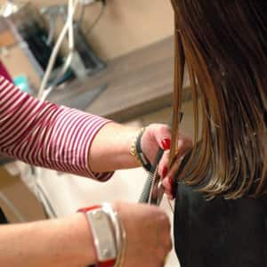 haircut for women, stylist cuts woman's hair. haircut, women haircuts, medium length haircuts