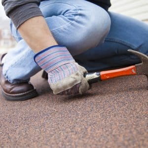 roofing contractor working with hammer