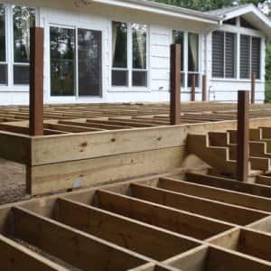 If your deck's frame isn't securely attached to your house with heavy-duty bolts, you could risk a collapse when the deck pulls away from the house (Photo courtesy of Samson Contracting LLC)