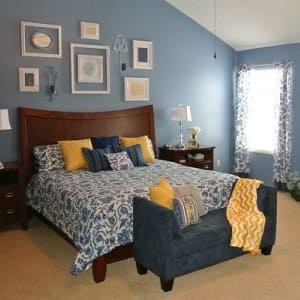 A bedroom decorated in French Country style with blue and yellow accents.