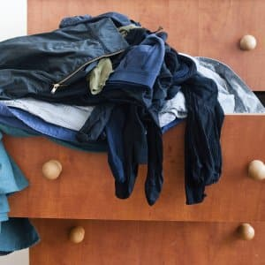 overflowing dresser drawers