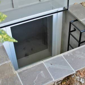 egress window with well and ladder and stone surround