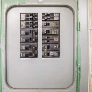 home circuit breaker on wall with switches visible
