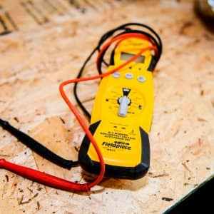 electrician's volt meter with positive and negative leads