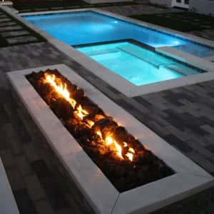 Fire elements have grown in popularity in recent years, both as gathering places and as purely aesthetic elements. (Photo courtesy of GreenSceneLandscape.com)