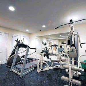 Once you decide on a space for your home gym, there are considerations to be made for equipment, and how large the gym can be, says Pillow. (Photo courtesy of Moss Building & Design)