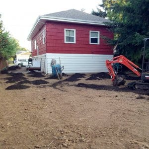Soil work in front of a home