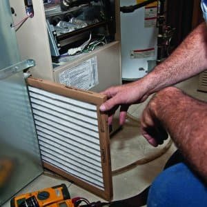 man installing hvac furnace air filter (Photo by Photo by Rick Miller)