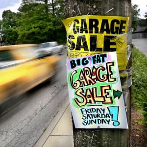 Garage sale signs on a telephone pole