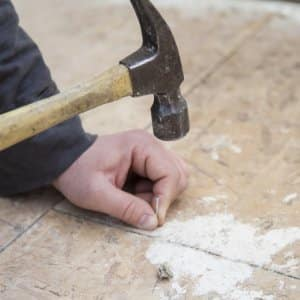 construction work with hammer and nail