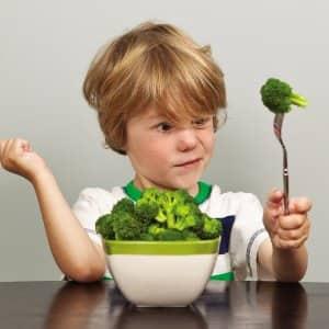 A boy with broccoli