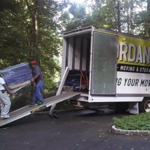 Movers load a moving truck