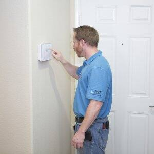 man working on alarm system