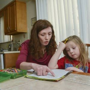 mom helping child with homework