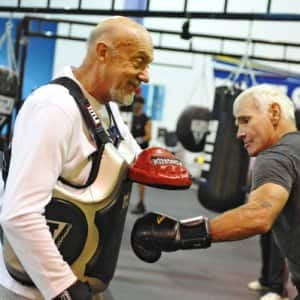 Rock Steady Boxing coach Kay Johns works with boxer Pete Stewart on the focus mitts. (Photo courtesy of Rock Steady Boxing)