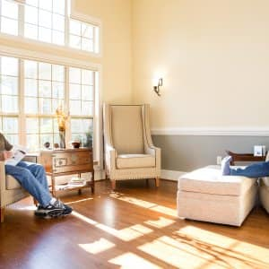 couple sits in living room