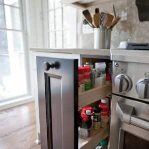 A Kitchen Stove With A Pull Out Drawer For Spices