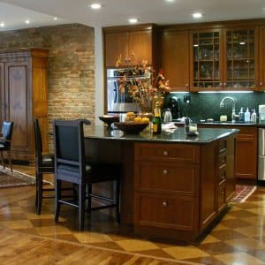 dark wood kitchen island with bar stools