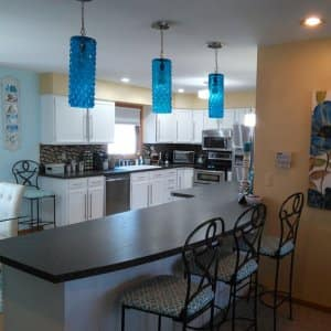 kitchen with blue paint and light fixtures
