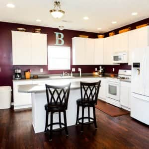 kitchen with white cabinets and appliances
