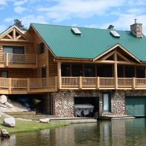 metal roof on lakeside log cabin