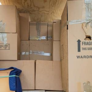 moving boxes stacked in truck (Photo by Eldon Lindsay)