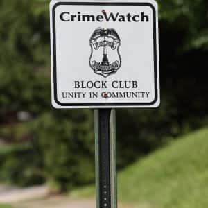 crime watch sign in neighborhood