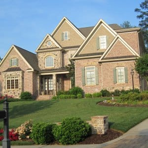 brick home on a hill