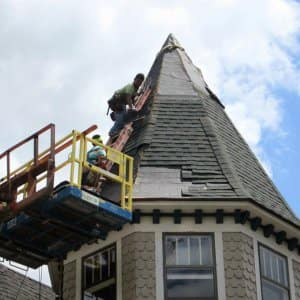 roofer installing asphalt shingle roof