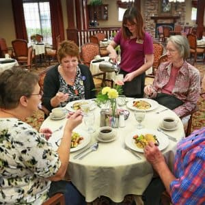 Residents dine together at a nursing home. (Photo by Photo by Frank Espich)