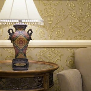 ornate wallpaper and lamp on table