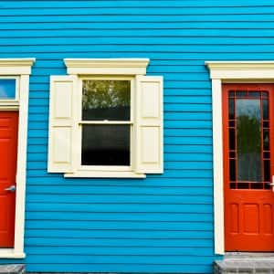 red doors on blue house