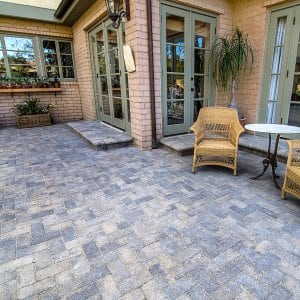 Pavers make a beautiful patio, but don't install them over concrete. (Photo courtesy of Go Pavers)