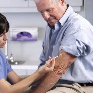 Man receives a shot