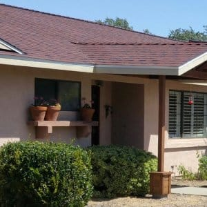 One Story House With New Red Roofing Shingles