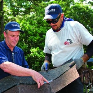 roofers discussing shingles