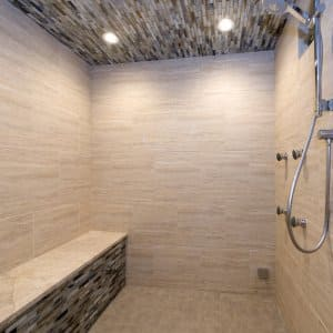 large tiled shower with built-in bench
