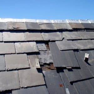 broken slate tiles slipping from roof