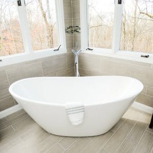 Large soaking bathtub shaped like basin inside bathroom