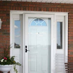 front entry door protected by a white storm door