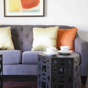 couch with four throw pillows (Photo by Katelin Kinney)