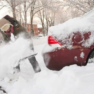 Make sure you use the proper equipment and technique to prevent an injury or heart attack while shoveling snow. (Photo by Steve C. Mitchell)