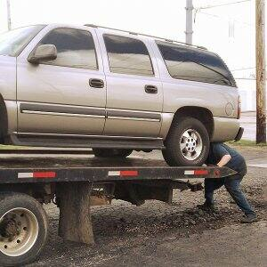 Loading car on tow truck.