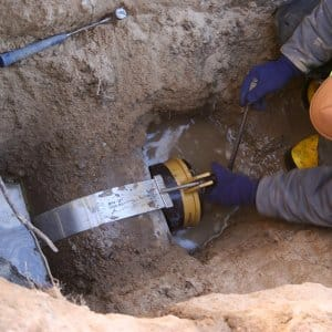 Man working on sewer line