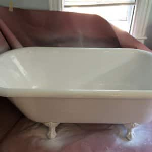 claw-foot bathtub in process of refinishing